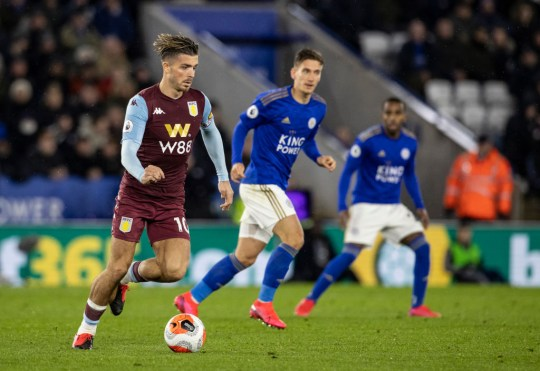 Jack Grealish runs with the ball during Leicester's Premier League match with Leicester City