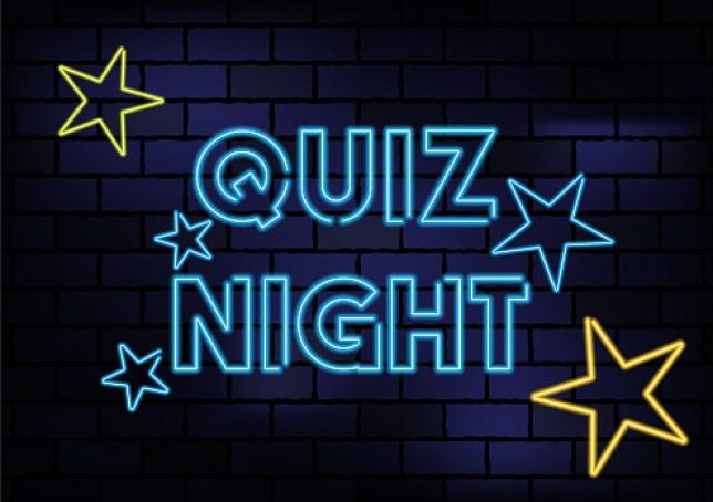 Quiz Night Sign Blue Neon Light On Dark Brick Wall