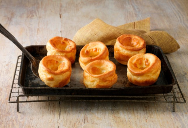 Beef dripping Yorkshire puddings on metal baking tray and wire rack.