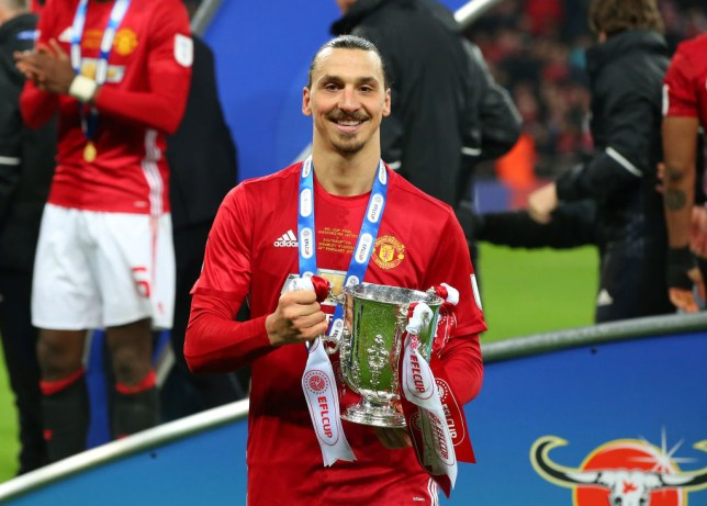 Zlatan Ibrahimovic celebrates with the EFL Cup after Manchester United's win over Southampton