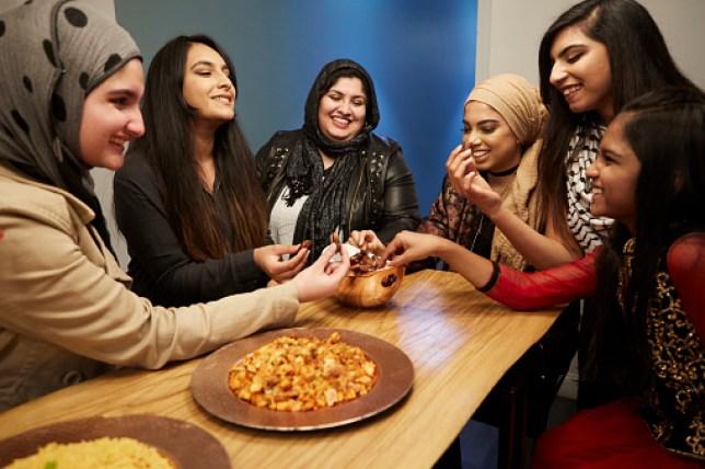 Muslim women enjoying some food