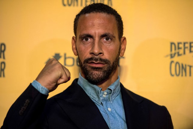 Former Manchester United defender Rio Ferdinand clenches his fist at a press conference in London