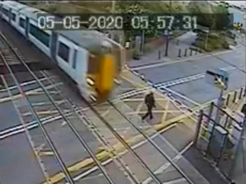 Warning after terrifying footage shows man inches from being hit by a train