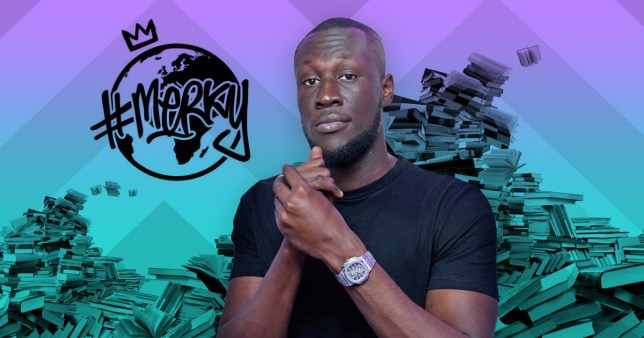 Stormzy and a pile of books behind him
