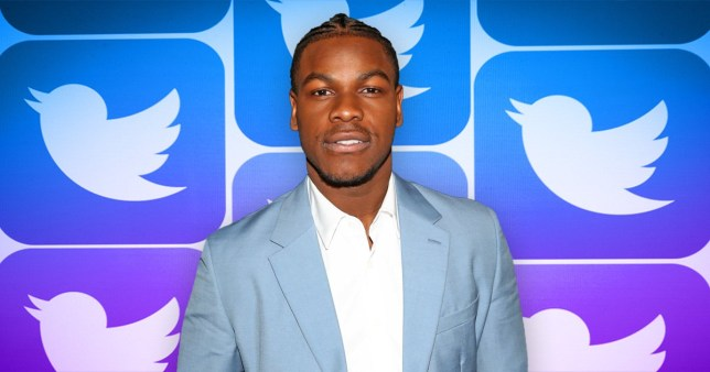 John Boyega pictured in front of Twitter logo