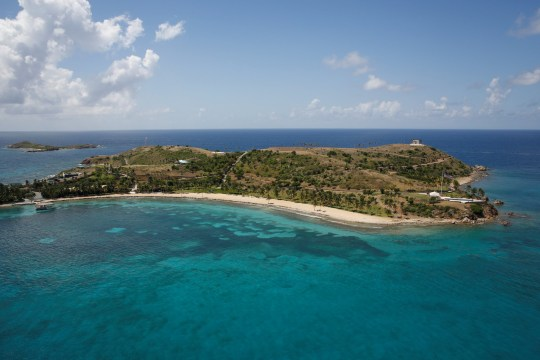FILE PHOTO: Little St. James Island, one of the properties of financier Jeffrey Epstein, is seen in an aerial view near Charlotte Amalie, St. Thomas, U.S. Virgin Islands July 21, 2019. REUTERS/Marco Bello/File Photo