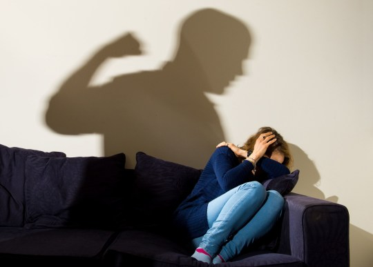 PICTURE POSED BY MODEL File photo dated 09/03/15 of a shadow of a man with a clenched fist as a woman cowers in the corner. A charity has raised fears the severity of domestic abuse will increase during lockdown. PA Photo. Issue date: Sunday April 19, 2020. Scottish Women?s Aid also said the risk will continue to worsen the longer the lockdown is in place as victims will be at home with their abuser without access to their usual support networks. See PA story HEALTH Coronavirus. Photo credit should read: Dominic Lipinski/PA Wire