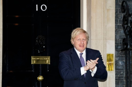 Prime Minister Boris Johnson outside 10 Downing Street in London joins in the applause to salute local heroes during Thursday's nationwide Clap for Carers to recognise and support NHS workers and carers fighting the coronavirus pandemic. PA Photo. Picture date: Thursday April 30, 2020. See PA story HEALTH Coronavirus. Photo credit should read: Aaron Chown/PA Wire