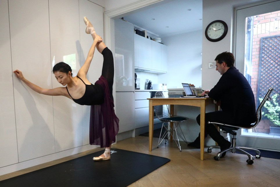 Yuhui Choe, First Soloist of The Royal Ballet practices as her husband, former Principal of the Royal Ballet, Nehemiah Kish works at their home in Wimbledon, following the outbreak of the coronavirus disease (COVID-19), London, Britain, May 1, 2020. REUTERS/Hannah McKay