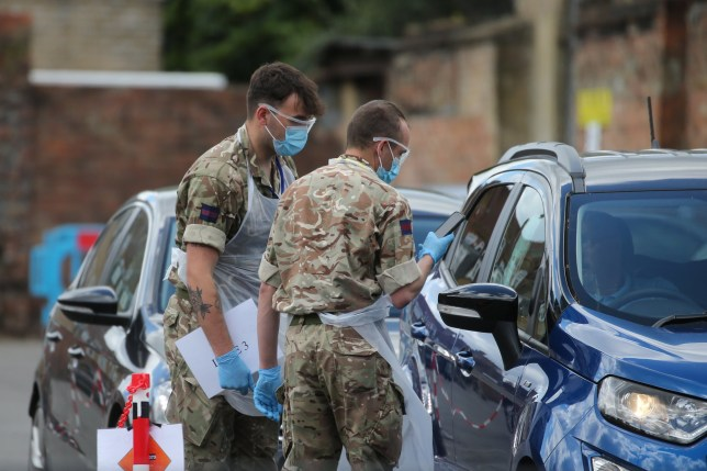 Soldiers help to conduct tests at a pop-up covid19 drive-through testing centre in Dalston, Hackney, east London, as the UK continues in lockdown to help curb the spread of the coronavirus. Picture date: Saturday May 2, 2020.