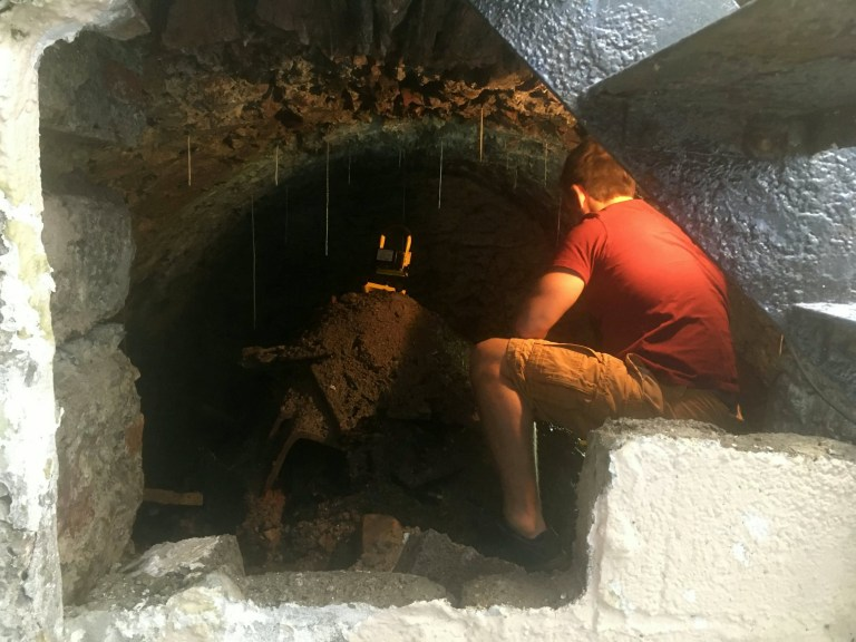 A man who drilled a hole in his wall was stunned to find a secret 120-year-old tunnel underneath his house. See SWNS story SWPtunnel. A man who drilled a hole in his wall was stunned to find a secret 120-year-old tunnel underneath his house. Jake Brown was doing some work at his newly bought home when he realised that one wall had different textures. He inspected further and made an opening big enough to get his head through to take another look. To his shock, Jake discovered there was a huge area underneath his home in Plymouth, Devon, so he opened it up to investigate.