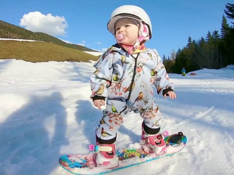 One-year-old expertly snowboards down Austrian alps