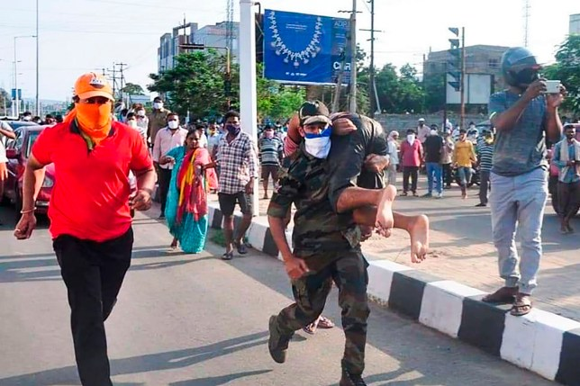 Rescuers evacuate people following a gas leak incident at an LG Polymers plant in Visakhapatnam on May 7, 2020. - At least five people have been killed and several hundred hospitalised after a gas leak at a chemicals plant on the east coast of India, police said on May 7. They said that the gas had leaked out of two 5,000-tonne tanks that had been unattended due to India's coronavirus lockdown in place since late March. (Photo by - / AFP) (Photo by -/AFP via Getty Images)
