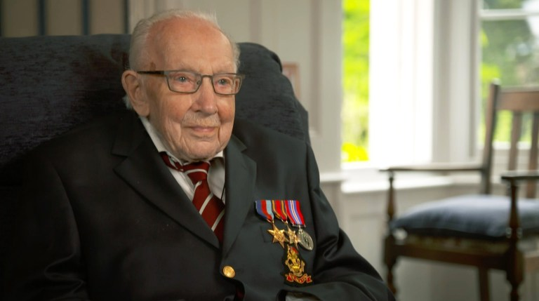 British Army Captain Tom Moore,100, wears his war medals as he speaks about his time serving in Burma during WWII