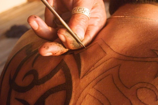 Erfan, and Iranian who lives in Sweden is given a traditional Thai bamboo tattoo