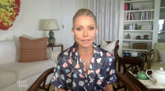 Kelly Ripa shows off her grays and admits cutting her own hair with kitchen scissors