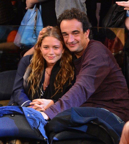 Mary-Kate Olsen and her husband Olivier Sarkosy sat together