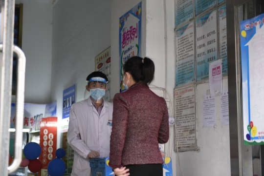 A woman purchases medicines at a pharmacy in Chuanying District of Jilin City, northeast China's Jilin Province, May 15, 2020. Jilin reported four new confirmed COVID-19 cases on Thursday, local health authorities said Friday.