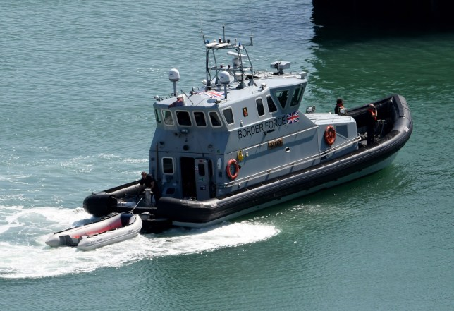 DOVER, ENGLAND - AUGUST 22: A fourth migrant boat is brought ashore by the UK Border Force on August 22, 2019 in Dover, England. In total six boats arrived to the Kent coast today, five vessels were intercepted by Border Force and a sixth landed on a beach in Sussex. The Home Office said 53 migrants, including six claimed minors, were found in the Channel would and be interviewed by immigration officers. A further 11, including children, were handed to over to Border Force after landing on Winchelsea Beach. (Photo by Steve Finn/Getty Images) 90 migrants intercepted