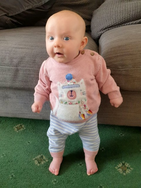 Parents amazed when eight-week-old baby daughter learns to stand ...