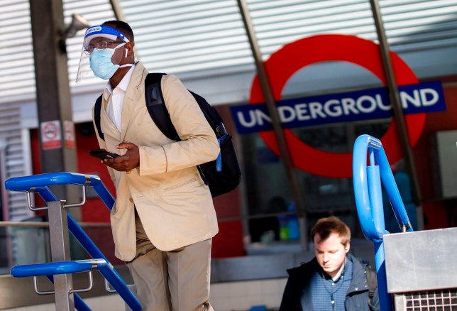 A commuters wearing PPE (personal protective equipment), including a face shield and face mask as a precautionary measure against COVID-19, exits Vauxhall station in central central London on May 18, 2020. - Britain on Sunday reported 170 more coronavirus deaths -- its lowest number since late March, when lockdown restrictions were introduced, although the figures from Northern Ireland were not included. Prime Minister Boris Johnson meanwhile acknowledged public frustration with the restrictions imposed to fight the virus. (Photo by Tolga AKMEN / AFP) (Photo by TOLGA AKMEN/AFP via Getty Images)