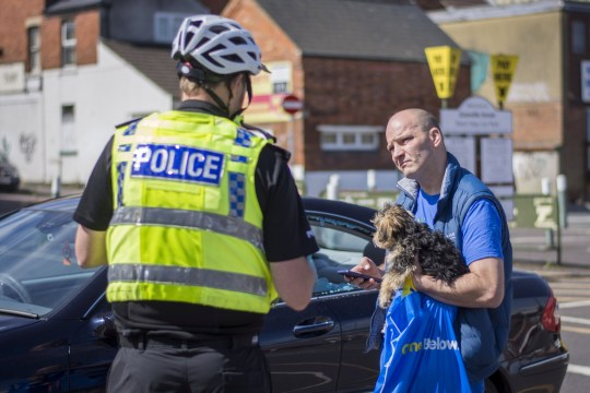 Police talk to a man whose car window was smashed by a stranger after he left his dog in his vehicle. See SWNS story SWBRdog A man who smashed the window of a stranger's car right in front of police has been told his actions were lawful - after spotting a puppy trapped inside. The unnamed rescuer told officers he would break into the vehicle if they didn't act after noticing the 'distressed' animal. So when he returned to an unchanged scene in the centre of Swindon, Wilts., he decided to take charge - shattering the glass and scooping the dog out. PSCOs later decided that the man would not face punishment after calming down the car's owner - deeming his actions lawful.
