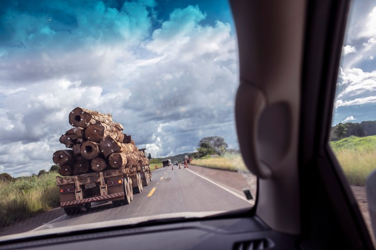 A timber-loaded truck travels along the federal highway BR-364 in the region of Ariquemes, Rond??nia, Brazil.