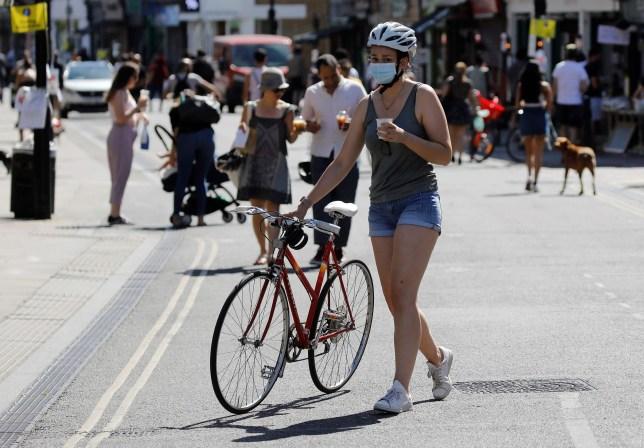 a woman wearing ppe in london