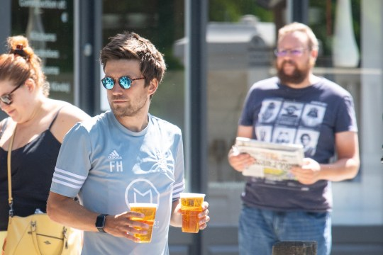 Customers queue for takeaway drinks outside the Althorp pub, in Wandsworth, London, after the introduction of measures to bring the country out of lockdown. PA Photo. Picture date: Friday May 22, 2020. See PA story HEALTH Coronavirus. Photo credit should read: Dominic Lipinski/PA Wire