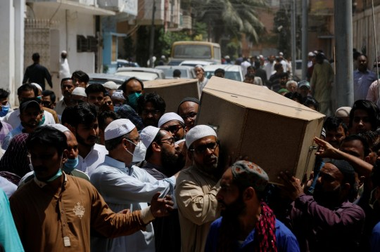 People carry the boxes of man and woman who were killed in a plane crash during a funeral in Karachi, Pakistan May 23, 2020. REUTERS / Akhtar Soomro