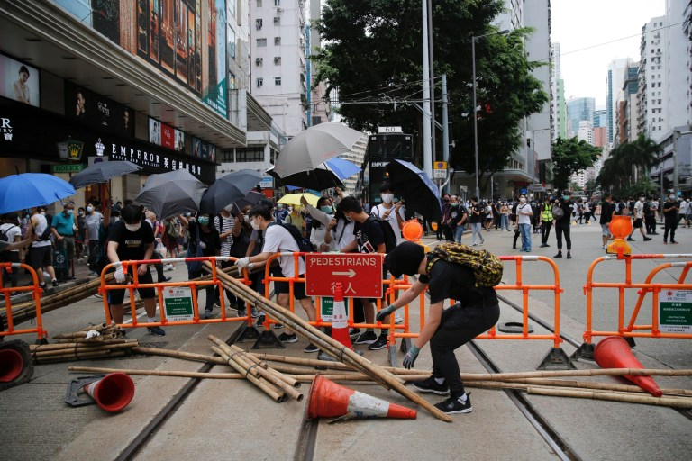 Protesters set up blockades during a protest against Beijing's national security legislation in Hong Kong, Sunday, May 24, 2020. Hundreds of protesters took to the streets Sunday to march against China???s proposed tough national security legislation for the city. (AP Photo/Kin Cheung)