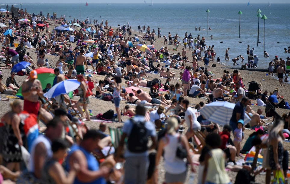 Beachgoers enjoy the sunshine as they sunbathe on the beach and play in the sea, on the May Bank holiday in Southend-on-Sea, south east England on May 25, 2020, after lockdown restrictions, originally put in place due the COVID-19 pandemic, were lifted earlier this month. - British Prime Minister Boris Johnson on Sunday backed top aide Dominic Cummings despite mounting pressure from within his own party to sack him over claims he broke coronavirus lockdown regulations. (Photo by Ben STANSALL / AFP) (Photo by BEN STANSALL/AFP via Getty Images)