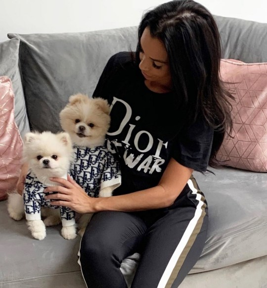 MERCURY PRESS. Pictured: Hollie Cummins, 30, with the dogs. A mum is so paw-ssionate about her two pampered Pomeranians, she spends more money spoiling them than on her SON. Hollie Cummins, 30, surprised dog-obsessed son London, nine, with pom pup Bear in 2018, despite her worries that getting a dog would be like caring for another child.But the mum-of-one grew so attached to Bear, she decided to buy another fluffy friend, Beau, just two weeks later - driving more than 11 hours to Bournemouth to pick him up from a top breeder. SEE MERCURY COPY