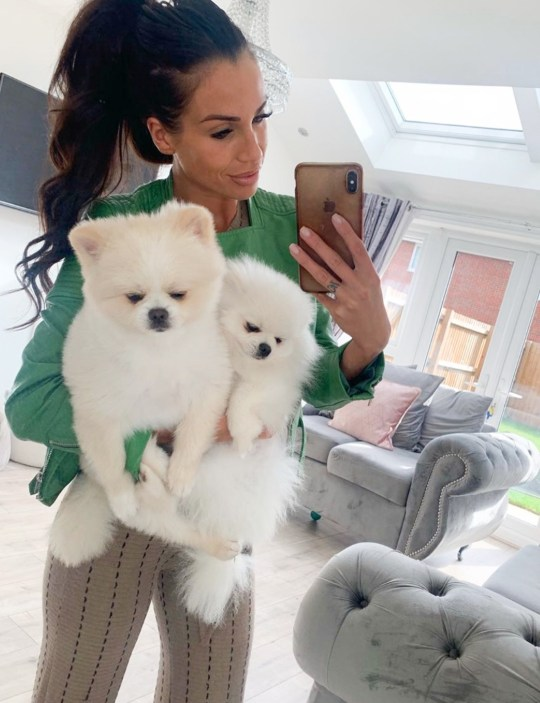 Hollie Cummins holding her two Pomeranians, Beau and Bear