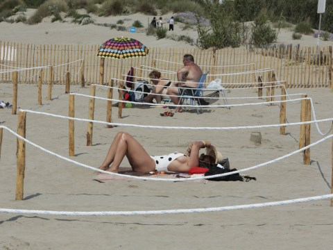 Beaches introduce social distancing to keep sunbathers apart in France