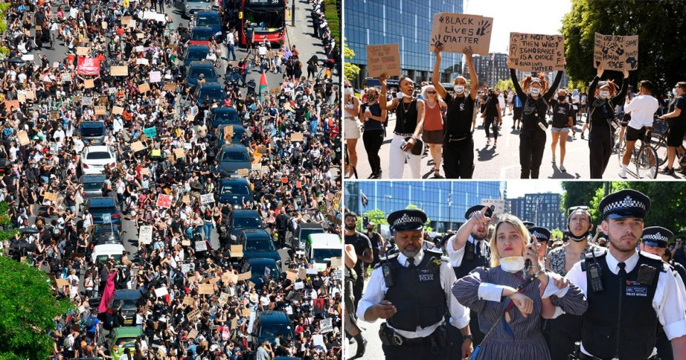 People hold up signs during a protest against the death in Minneapolis police custody of African-American man George Floyd, London, Britain, May 31, 2020. REUTERS/John Sibley