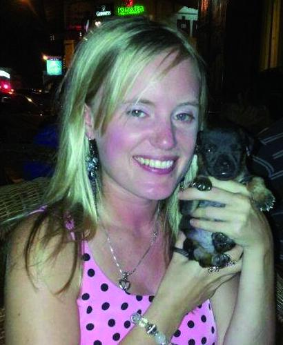 Victoria Bryson holding a puppy