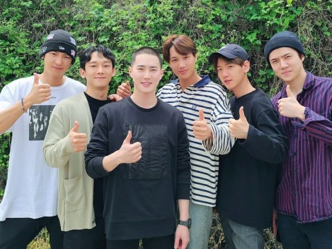 EXO members reunite to give Suho a good send off as he enlists in the military