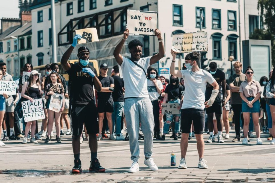 Three friends at a Black Lives Matter protest