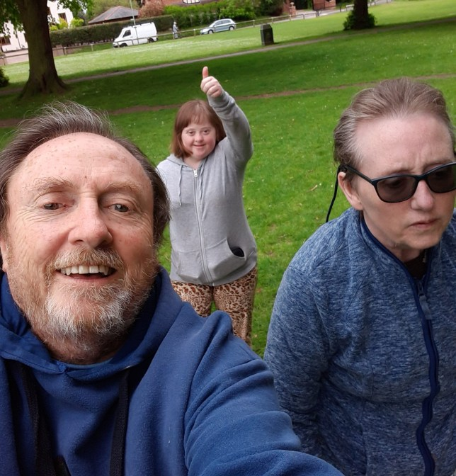 John Ley with his daughter Katie, who has Down's Syndrome, and his wife Linda, who has early onset Alzheimer's, with the family out in the park.