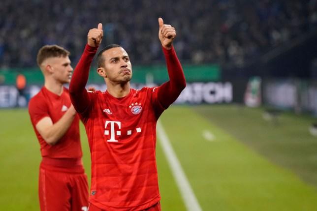 Thiago Alcantara  gives the thumbs up to Bayern fans