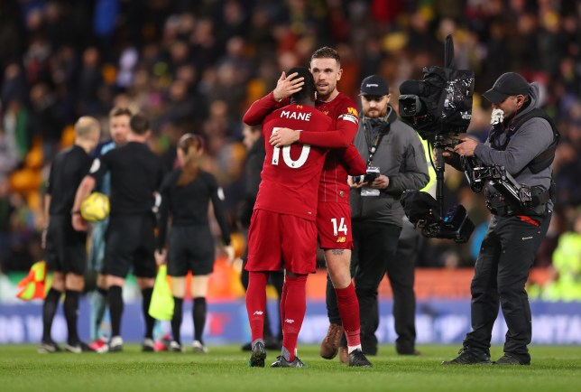 Sadio Mane and Jordan Henderson celebrate after Liverpool's victory over Norwich in the Premier League