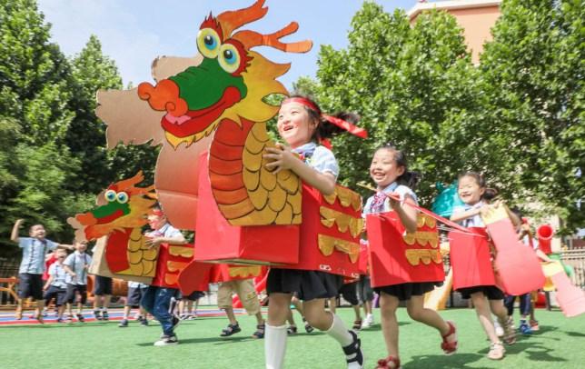 Chinese children celebrate the Dragon Boat Festival