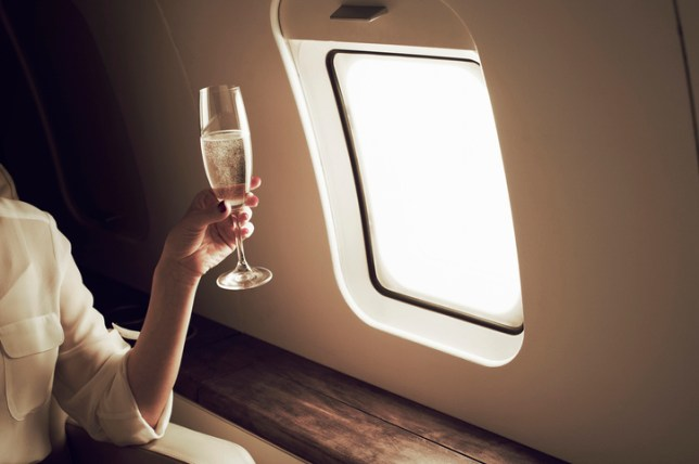 Businesswoman relaxing aboard private jet
