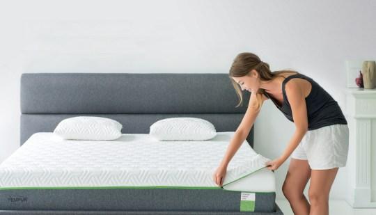 Lady fitting TEMPUR® mattress cover
