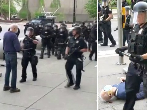 Police march past man bleeding from the ear after shoving him to the ground