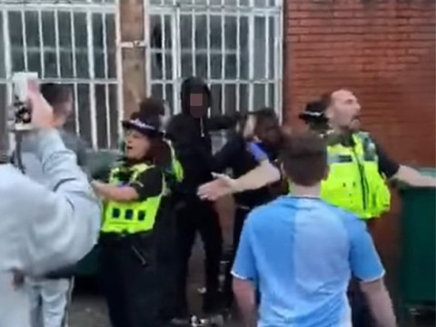 Group of football fans chase two men 'after one was seen with knife'