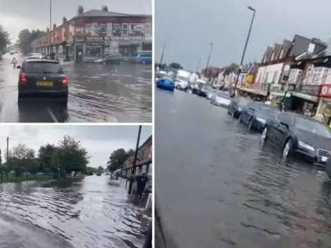 Cars slide through flooded roads as sudden torrential rain batters Britain