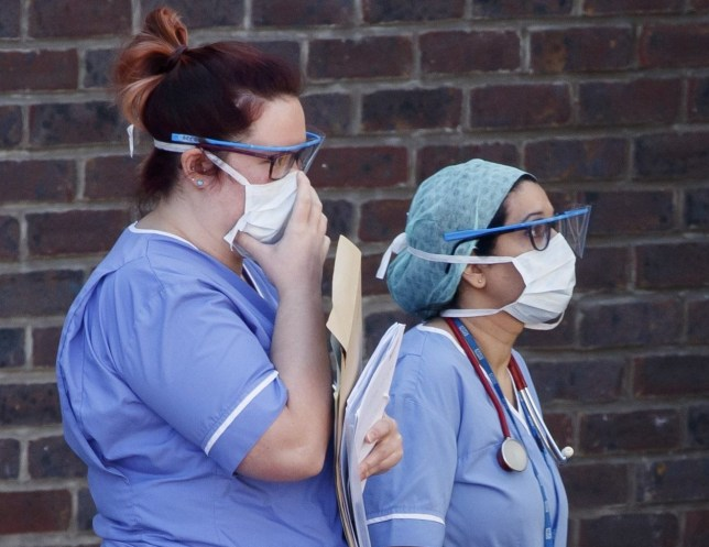 Hospital staff wear face masks outside Doncaster Royal Infirmary