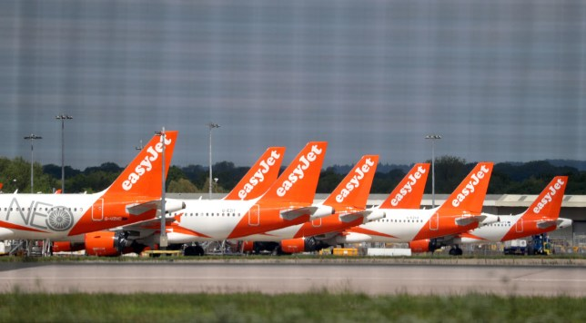 EasyJet planes grounded due to the coronavirus outbreak are parked at Gatwick Airport in Sussex